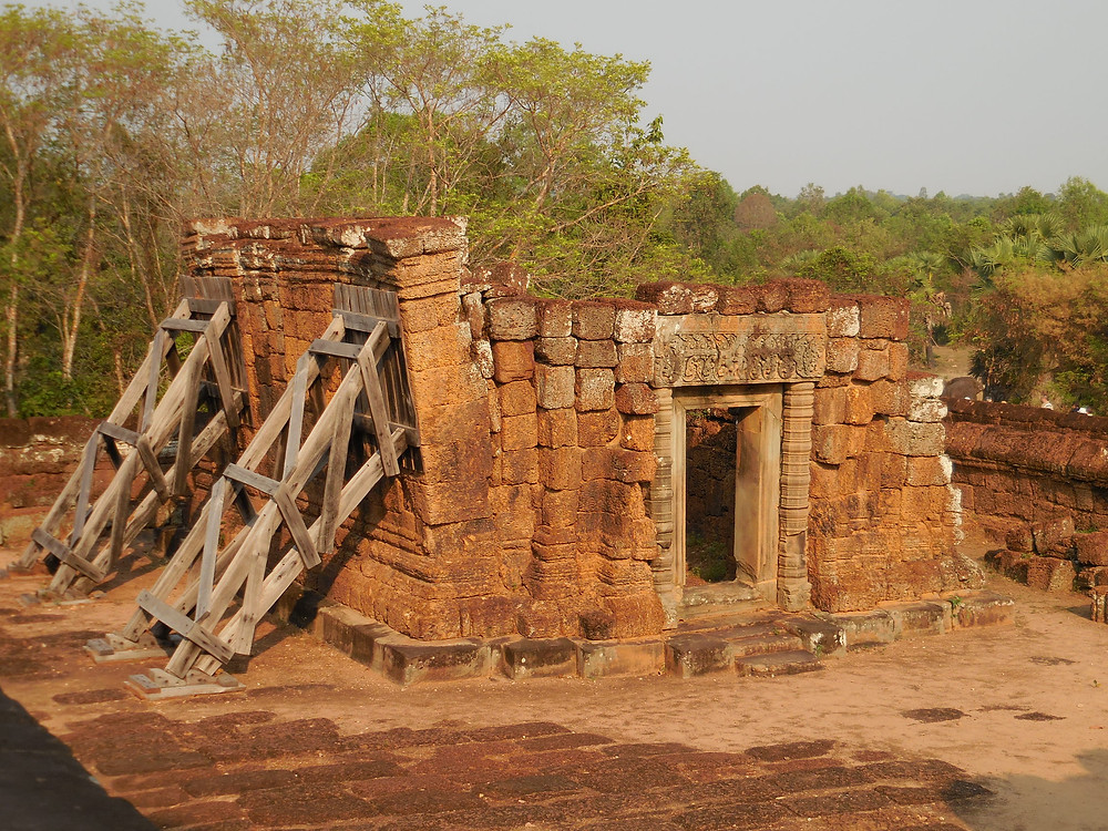 Wooden supports keep part of East Mebon from falling down