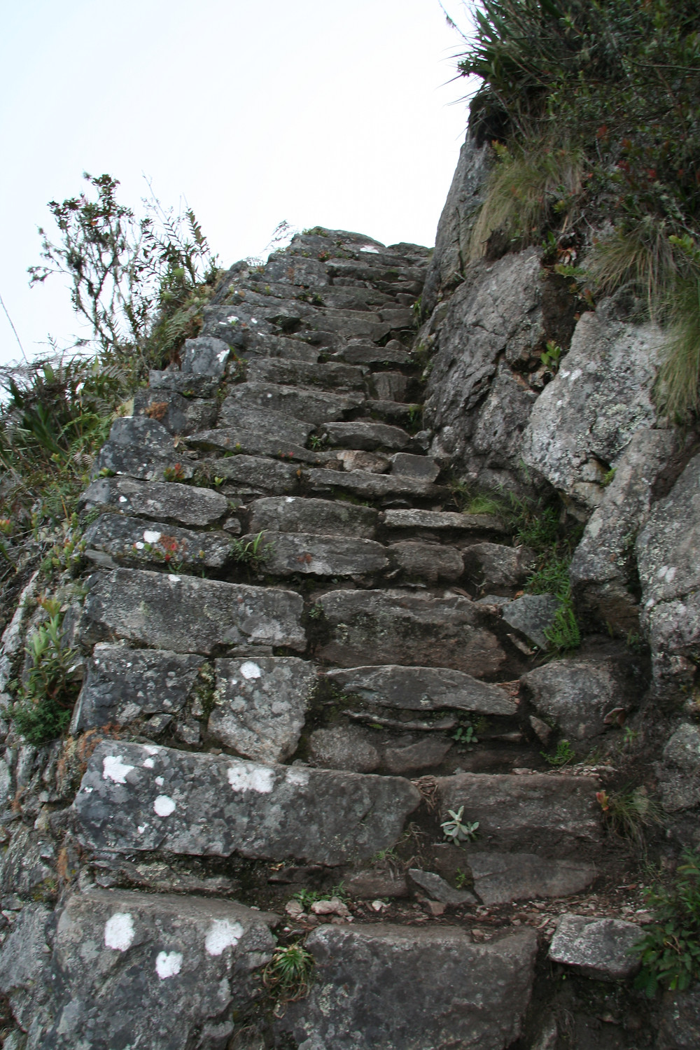 The steps become steeper towards the top. Since there are no handrails, you brace yourself on the mountainside or the stone steps