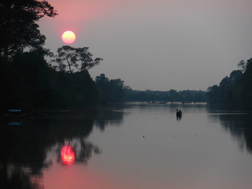 Sunset from the South Gate of Angkor Thom. There were only a few people here. Such a beautiful experience.