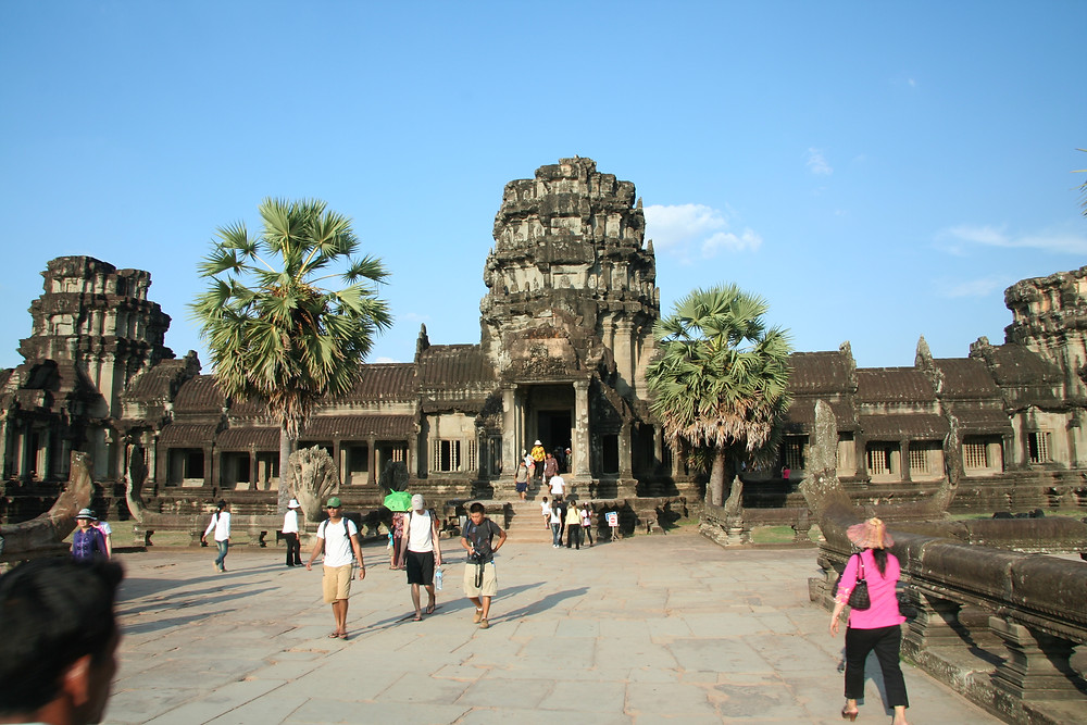 Approaching the entrance to Angkor Wat on a clear blue-sky day