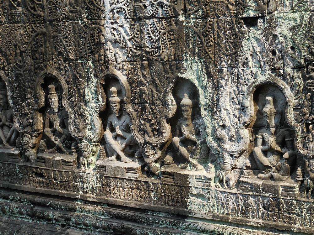 The original Buddha images have been removed and replaced with Hindu figures. Similar to other temples at Angkor, Preah Khan, originally built as a Buddhist temple, was later converted to a Hindu temple.