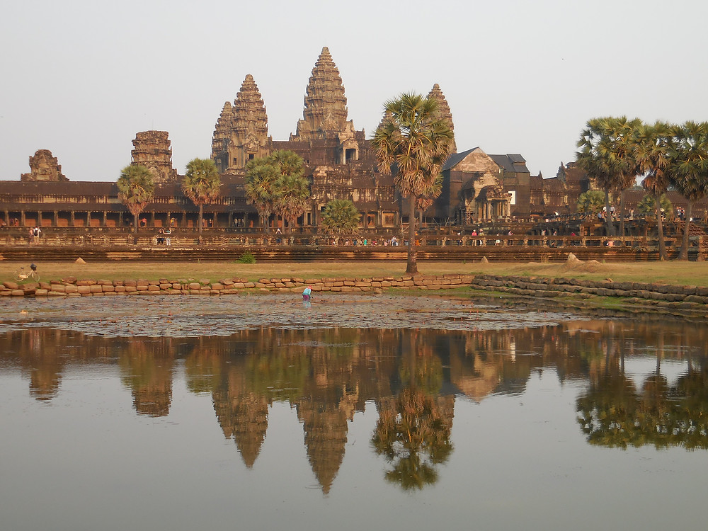 The pond in front mirrors the temple of Angkor Wat