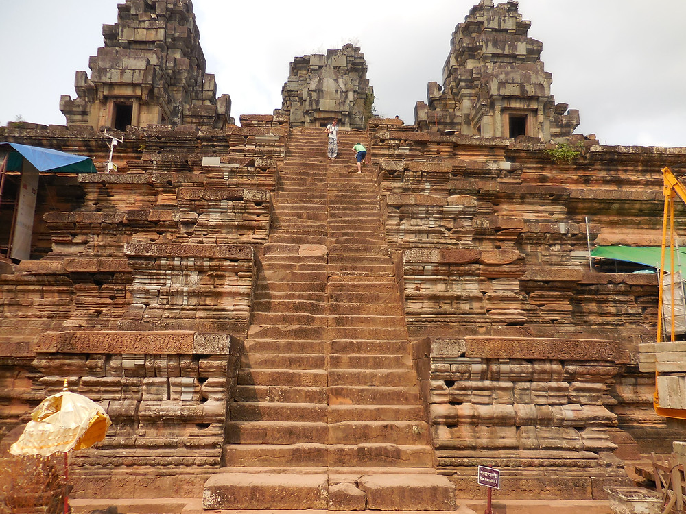 Built in the 10th - 11th century as a temple mountain, Ta Keo is the first to be constructed wholly of sandstone. The steps to the top are steep and somewhat narrow.