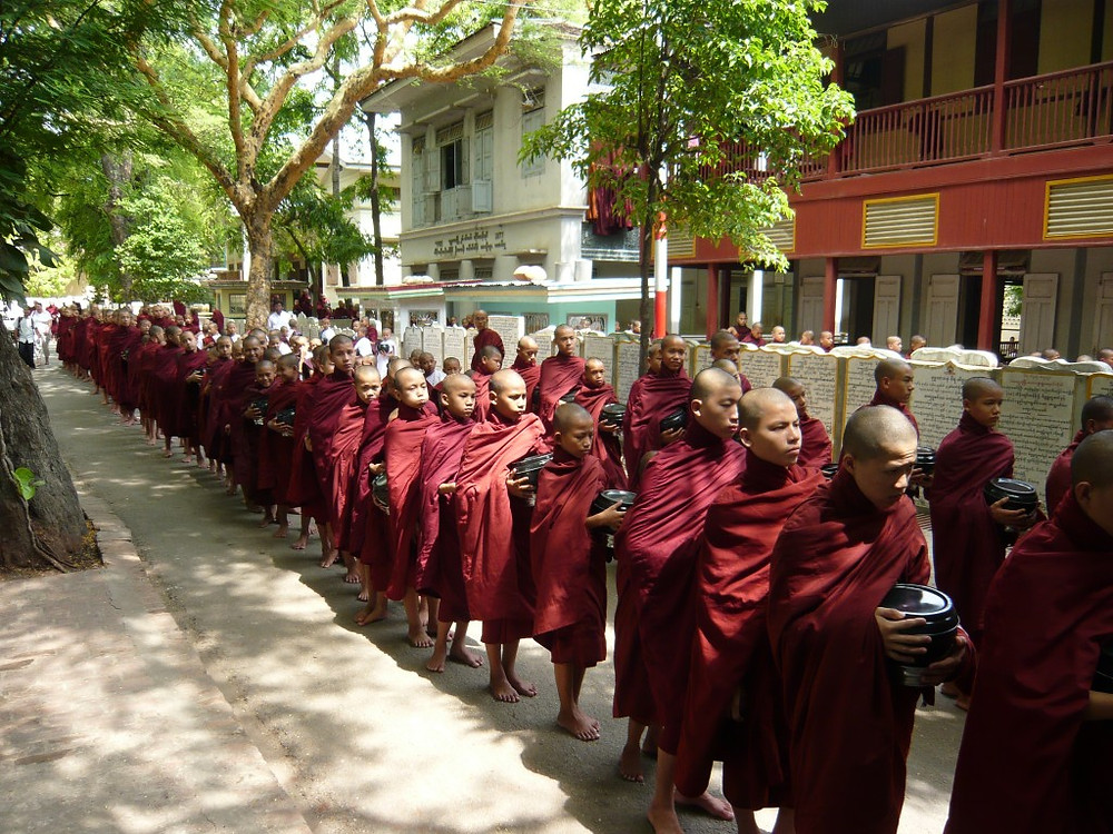 Monks waiting in line for lunch at Mahagandayon Monastery in Amarapura