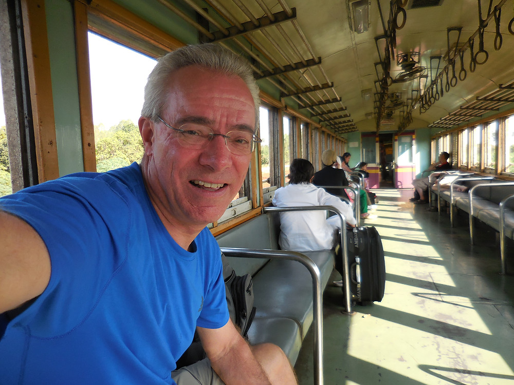 Riding on the Death Railway train from the station at Nam Tok to Kanchanaburi