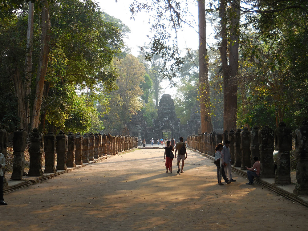 The walk to the gopura (or outer wall entrance) at Preah Khan is beautiful in the early morning