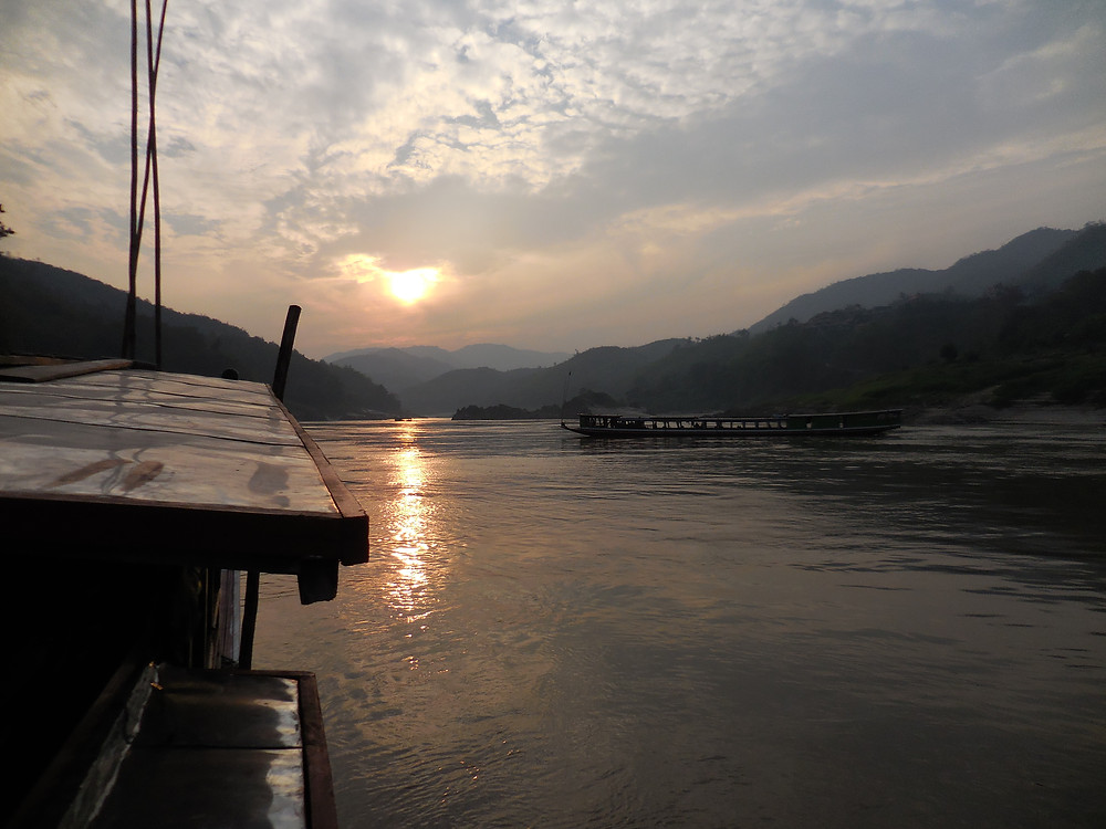 Sunset on the Mekong River as we pull into Pakbeng, Laos
