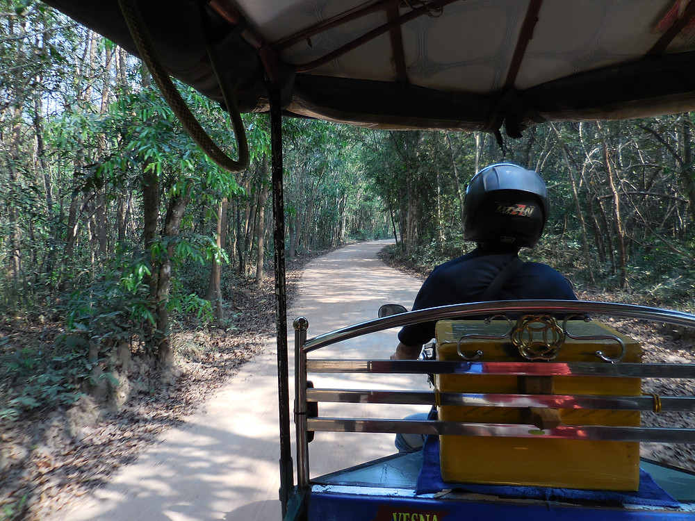 To reach Ta Nei, my tuk tuk driver, Veasna, has to take a dirt road.