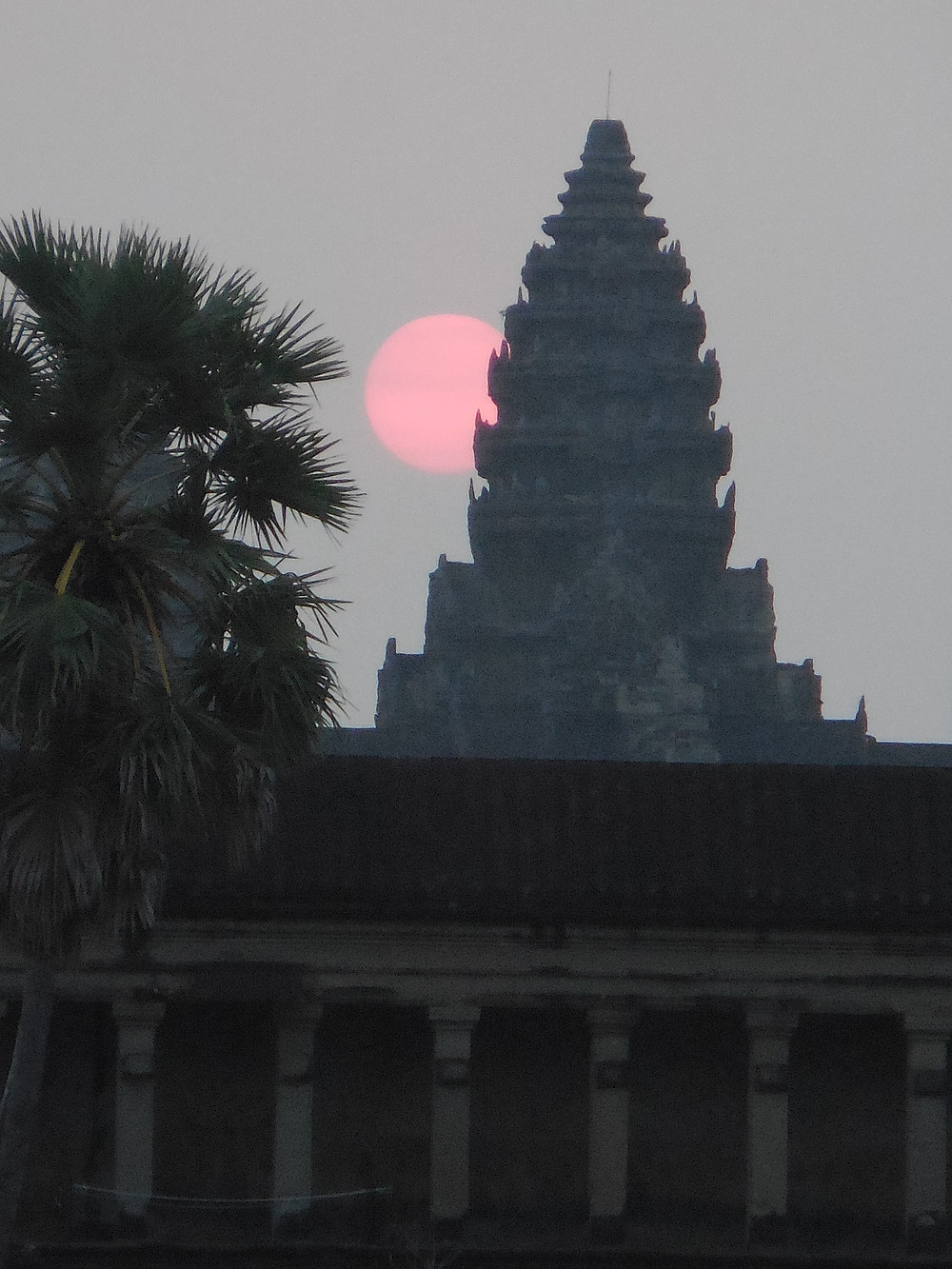 Sunrise over the central tower of Angkor Wat