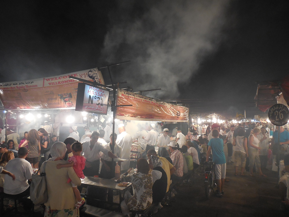 It's hard to get a seat at the food stalls in Jemaa el Fna at night. What an experience though!!!