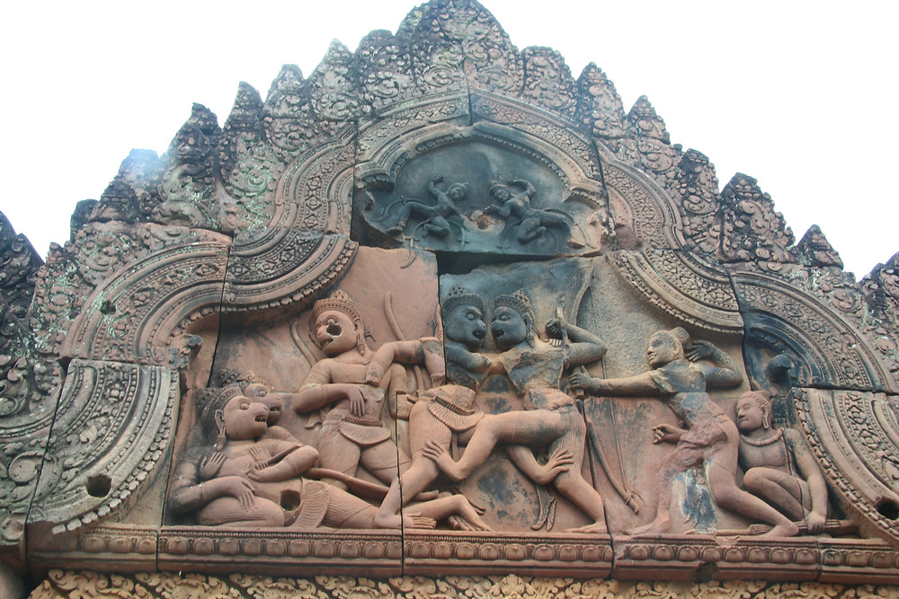 There are intricate designs and figures throughout Banteay Srei