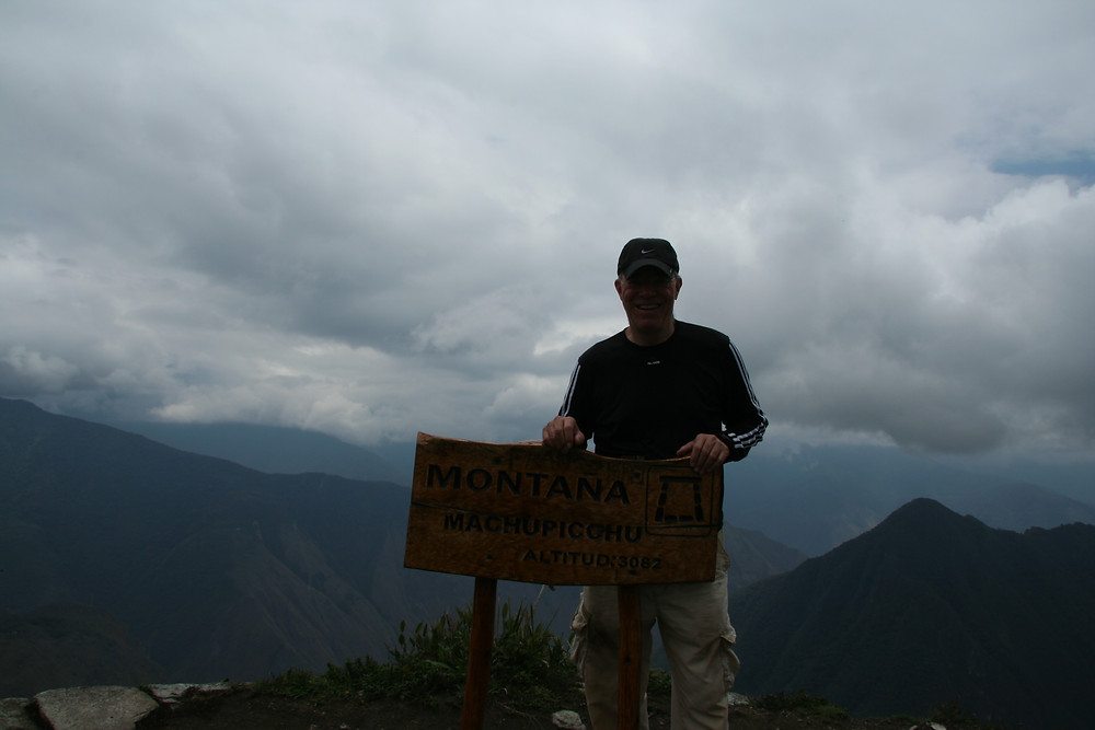 The sign at the top of Machu Picchu Montana indicates the elevation is 3,082 meters (10,111 feet)