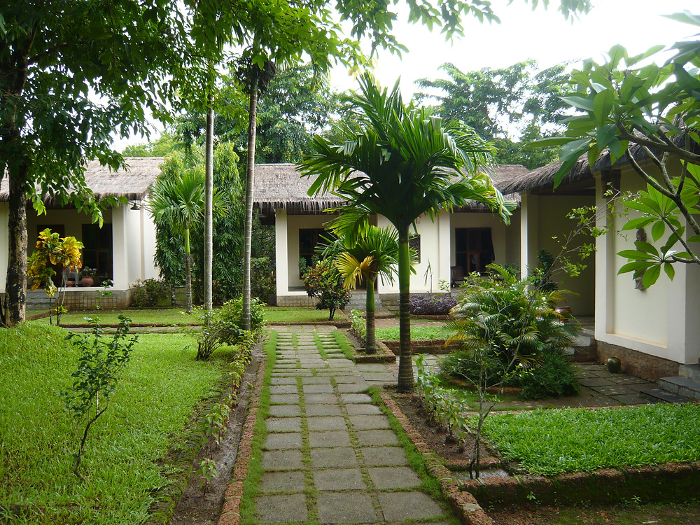 The bungalow-style rooms, of the Golden Sunrise Hotel, surround a nicely landscaped garden