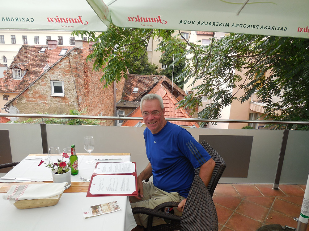 Sitting on the terrace of Kulinarijat Restaurant in the old town