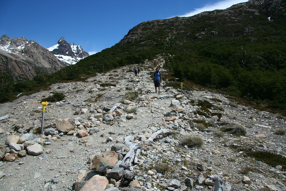 The steep climb up the last mountain is full of rocks and boulders that must be navigated around