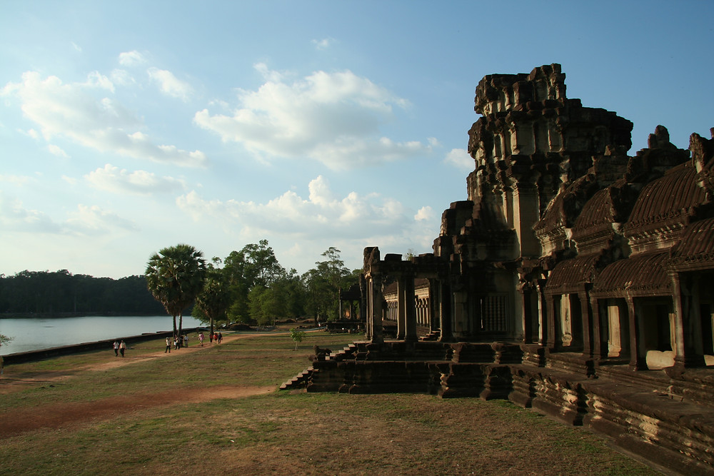 Looking along the front wall of Angkor Wat with the moat off to the side in the late afternoon sun