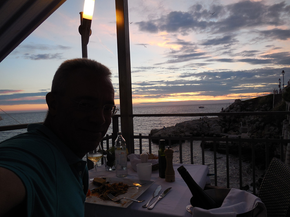 Watching the sunset from my table at Puntulina - such a stunning view
