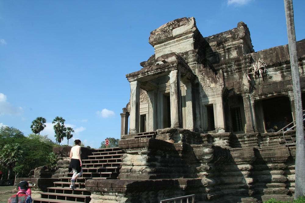 There are many stairs to climb at Angkor Wat. A clear blue sky can make for vivid photos during mid-day.