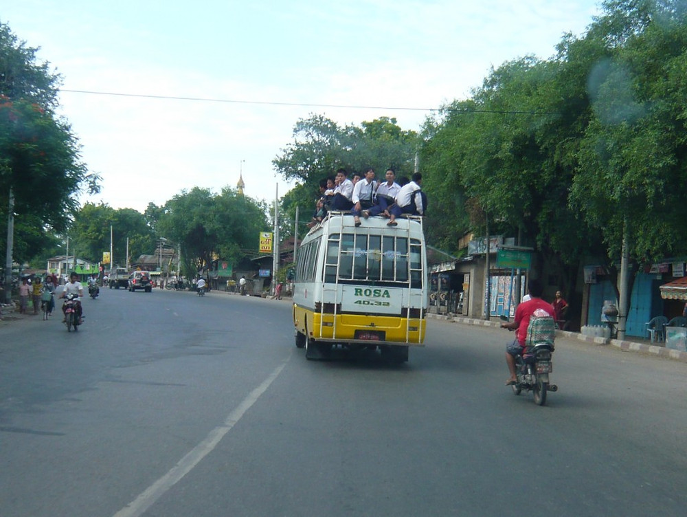 On the drive to the airport, I noticed the school bus ahead of us with the children on the roof of the bus - interesting