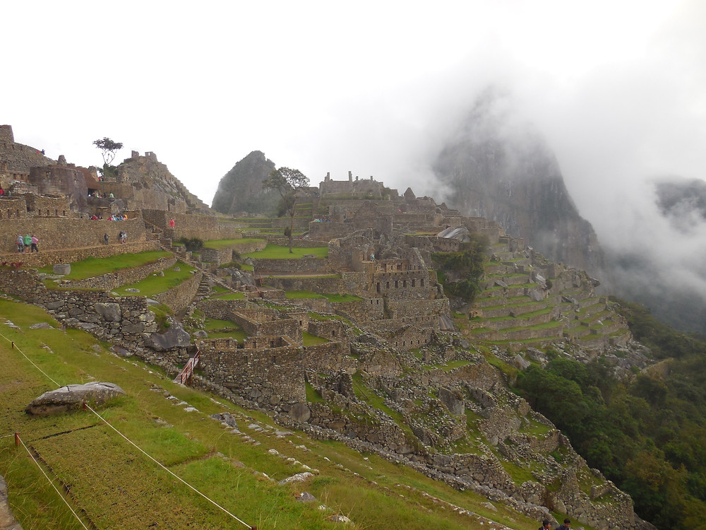 It's early morning at Machu Picchu with Huayna Picchu in the background