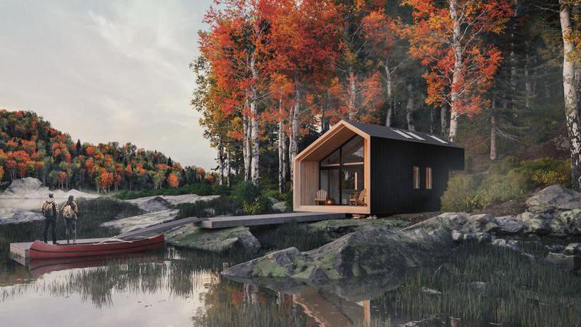 Paar im Woodenfactory Holzhaus am See