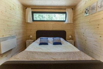 Schlafzimmer im Woodenfactory Holzhaus