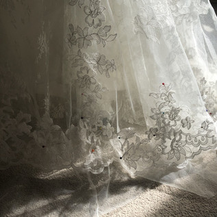 Positioning the lace edging along a tulle hem
