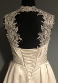 Bespoke lace keyhole created on a completely plain satin strapless dress