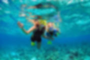 Happy family - mother, kid in snorkeling