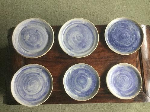 Blue swirl and wood ash glaze plates