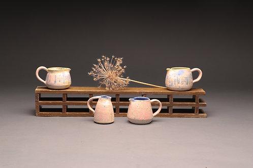 Four  decorative jugs
