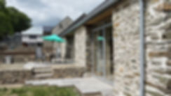 Modern extension to historic range of barns. Argent Architects, Pembrokeshire, West Wales