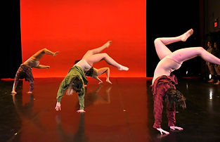 dancers perfoming a backbend