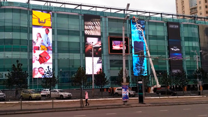 LED screens on the facade of the shopping center Sady Pobedy