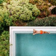 man-by-pool-aerial-view-jungle.jpg
