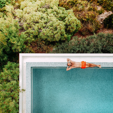 man-by-pool-aerial-view-jungle.jpg