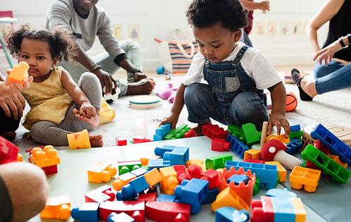 Diverse children enjoying playing with t