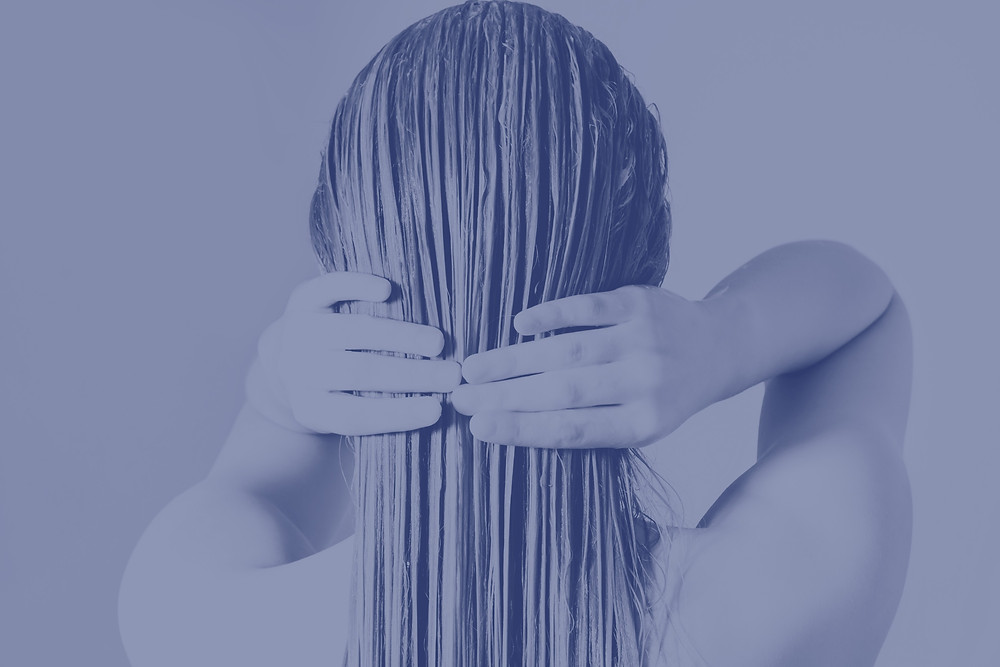 Lady washing her hair extensions