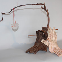 Why Dost Not Speak?   Cast Glass, Wood, Leather, Rafia   18 x 12 x 12