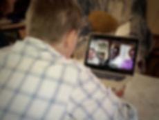 JT Lewis Skypes with Genocide Survivors in Rwanda
