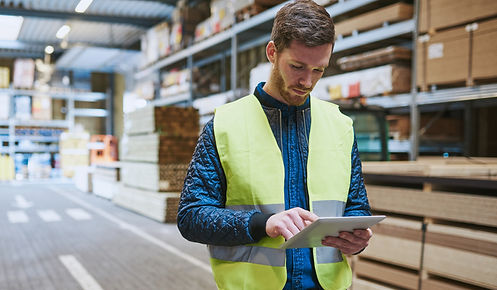 young-warehouse-worker-consulting-a-tabl