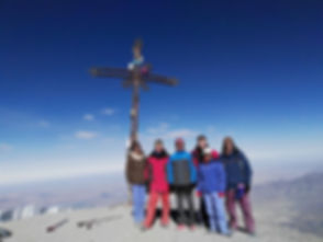 A group of tourists at the summit of the Misti Volcano