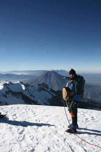A tourist at the Chachani Volcano summit.