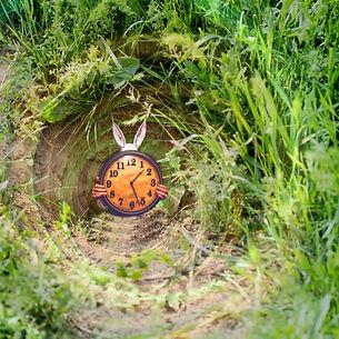 Rabbit holding clock in swirling rabbit hole