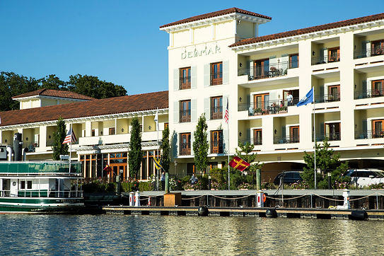 The outside of the Delamar Hotel on the water