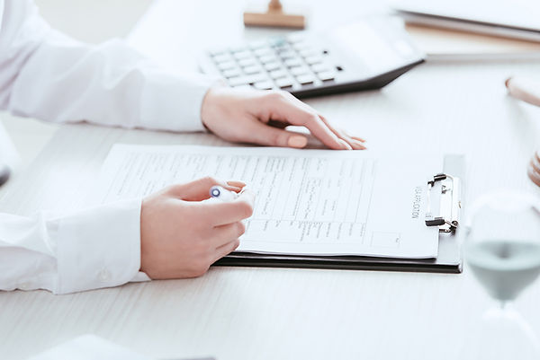 Importance Of Healthcare Directives Woman Filling Paperwork, importance of healthcare directives, emergency legal documents, legal healthcare documents, healthcare directive