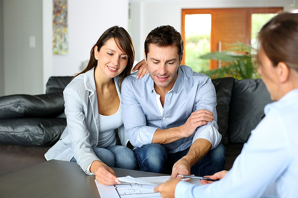 young couple signing estate plan Estate Plan Mistakes top estate attorney trust and estate lawyer or estate planning