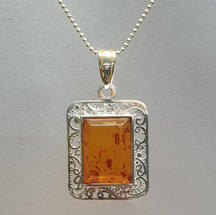 Sterling silver Baltic amber filigree pendant on long poppet chain