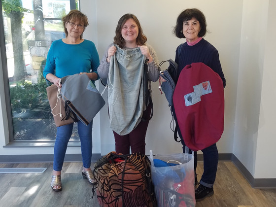 Duffel bags presented to Youth In Need