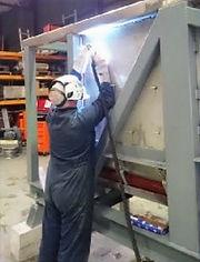 alan-welding-a-digester_edited.jpg